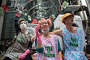 Extinction Rebellion 'Dirty Scrubbers' old fashioned washer women in curlers wash and launder their 'dirty money' and greenwash stains outside Lloyd's in the City of London financial district in a performance designed to highlight the corruption of big business and banking on 9th September 2020 in London, United Kingdom. The activists shouted out for people to come from the banks and to bring their dirty money to be cleaned in their washing machines. Extinction Rebellion is a climate change group started in 2018 and has gained a huge following of people committed to peaceful protests. These protests are highlighting that the government is not doing enough to avoid catastrophic climate change and to demand the government take radical action to save the planet.