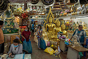 Freshly cast buddha statues are sold in the streets around Wat Suthat and the Giant Swing in Bangkok