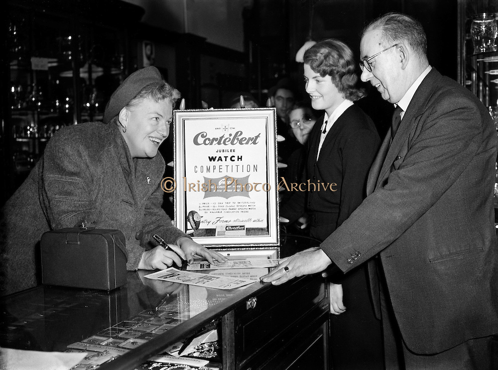 Gracie Fields at Messrs Jameson and Co. Ltd. O'Connell St..05/12/1952..Dame Gracie Fields, DBE (born Grace Stansfield, 09/01/1898 - 27/09/1979), was an English-born, later Italian-based actress, singer and comedienne and star of both cinema and music hall...At Jameson Jewellers Ms Fields is filling an entry card for the 'Cortebert Jubilee Watch Competition' where one could win a 10 Day Trip to Switzerland if they correctly guessed the number of parts in the watch in question!