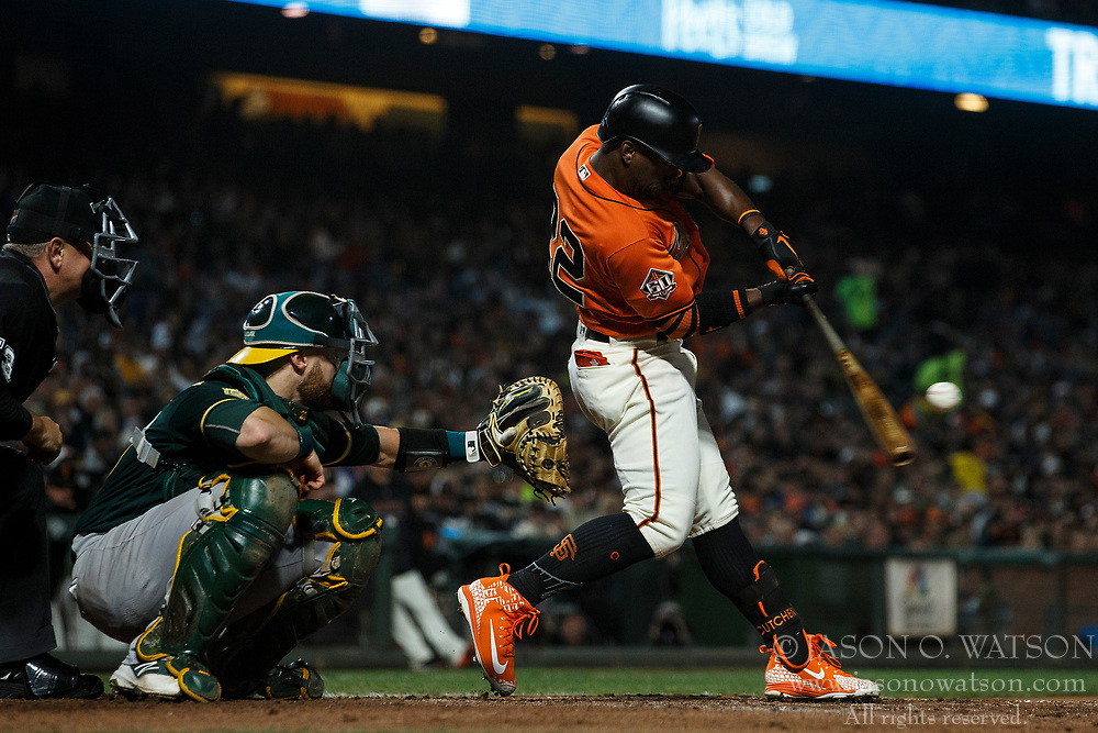 SAN FRANCISCO, CA - JULY 13: Andrew McCutchen #22 of the San Francisco Giants hits a single against the Oakland Athletics during the sixth inning at AT&T Park on July 13, 2018 in San Francisco, California. The San Francisco Giants defeated the Oakland Athletics 7-1. (Photo by Jason O. Watson/Getty Images) *** Local Caption *** Andrew McCutchen