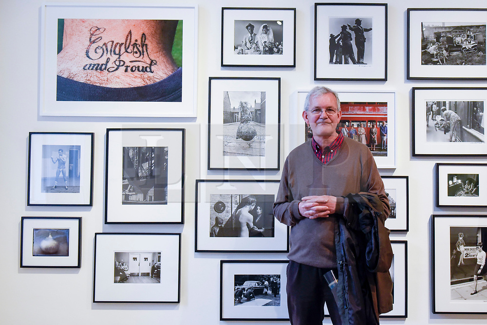 """London, UK.  17 May 2017. Martin Parr, Magnum photographer, stands in front of a collection of works by variosu photographers. Parr's work """"English and Proud"""" is seen top left. Preview of Photo London 2017 at Somerset House.  Held for the third time, the event showcases the best in contemporary photography, from 89 galleries from 16 different countries, for collectors and enthusiasts and will be on from 18 - 21 May. Credit: Stephen Chung / Alamy Live News"""