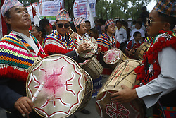August 9, 2016 - Kathmandu, Nepal - Nepalese people from various ethnic groups play traditional instruments while taking part in a rally to mark International Day of the World's Indigenous Peoples in Kathmandu, Nepal on Tuesday, August 9, 2016. This day is celebrated worldwide to promote and protect the rights of the world's indigenous population. (Credit Image: © Skanda Gautam via ZUMA Wire)