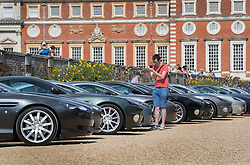 © Licensed to London News Pictures. 02/09/2017. London, UK. A visitor to the Concours of Elegance show photographs a long line of classic Aston Martin cars on display in the grounds of Hampton Court Palace. The Concours of Elegance brings together, over three days, a selection of 60 of the rarest cars from around the world some of which have never been seen before in the UK. Each car owner is asked to vote on the other models on display to decide which car is considered to be the 'Best of Show'. The show also displays of hundreds of other fine motor cars, including entrants to The Club Trophy. Photo credit: Peter Macdiarmid/LNP