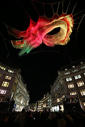 © Licensed to London News Pictures. 14/01/2016. London, UK. A giant illuminated net sculpture entitled '1.8 London' hangs above Oxford Circus. Lumiere London is a major new light festival that, over four evenings, brings together<br /> some of the world's most exciting artists working with light utilising large-scale video-mapped projections, interactive pieces and installations. Photo credit: Peter Macdiarmid/LNP