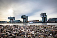 view from the banks on the river Rhine in the district Deutz to the Crane Houses in the Rheinau harbor, Cologne, Germany.<br /> <br /> Blick vom Rheinufer in Deutz zu den Kranhaeusern im Rheinauhafen, Koeln, Deutschland.
