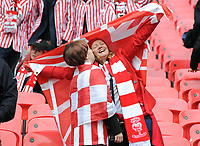 Football - 2018 Checkatrade (EFL) Trophy - Lincoln City vs. Shrewsbury Town<br /> <br /> Lincoln fans celebrate with a kiss, at Wembley Stadium.<br /> <br /> COLORSPORT/ANDREW COWIE