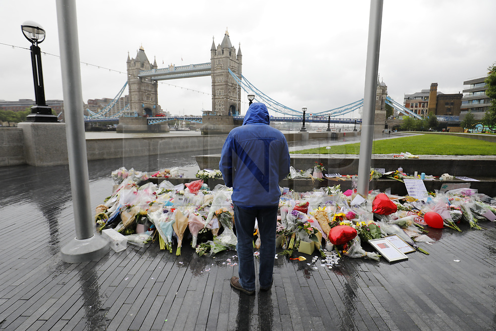 © Licensed to London News Pictures. 06/06/2017. London, UK.         A minutes silence is held outside City Hall, next to a flower tribute in central London for those who lost their life in a terrorist attack on Saturday evening. Three men attacked members of the public  after a white van rammed pedestrians on London Bridge. Ten people including the three suspected attackers were killed and 48 injured in the attack. Photo credit: Tolga Akmen/LNP