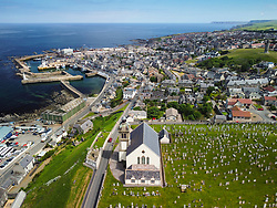 Aerial view from drone of church and town of Macduff on Moray Firth coast in Aberdeenshire, Scotland, UK
