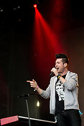 © Licensed to London News Pictures . 08/06/2014 . Heaton Park , Manchester , UK . Dan Smith leading Bastille on the Main Stage . The Parklife music festival in Heaton Park Manchester . Photo credit : Joel Goodman/LNP