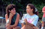Cousins age 28 conversing on family picnic. Les Cheneaux Islands Lake Huron Cedarville  Michigan USA