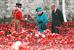 Queen Elizabeth II and the Duke of Edinburgh visit the Tower of London's Blood Swept Lands and Seas of Red installation.