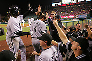 CHICAGO - OCTOBER 15:  Carl Everett of the Chicago White Sox is greeted by teammates during Game 4 of the American League Championship Series against the Los Angeles Angels of Anaheim at Angels Stadium on October 15, 2005 in Anaheim, California.  The White Sox defeated the Angels 8-2.