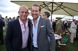 Left to right, CARLO CARELLO and JAKE PARKINSON-SMITH at the Cartier Queen's Cup Polo Final, Guards Polo Club, Windsor Great Park, Berkshire, on 17th June 2012.