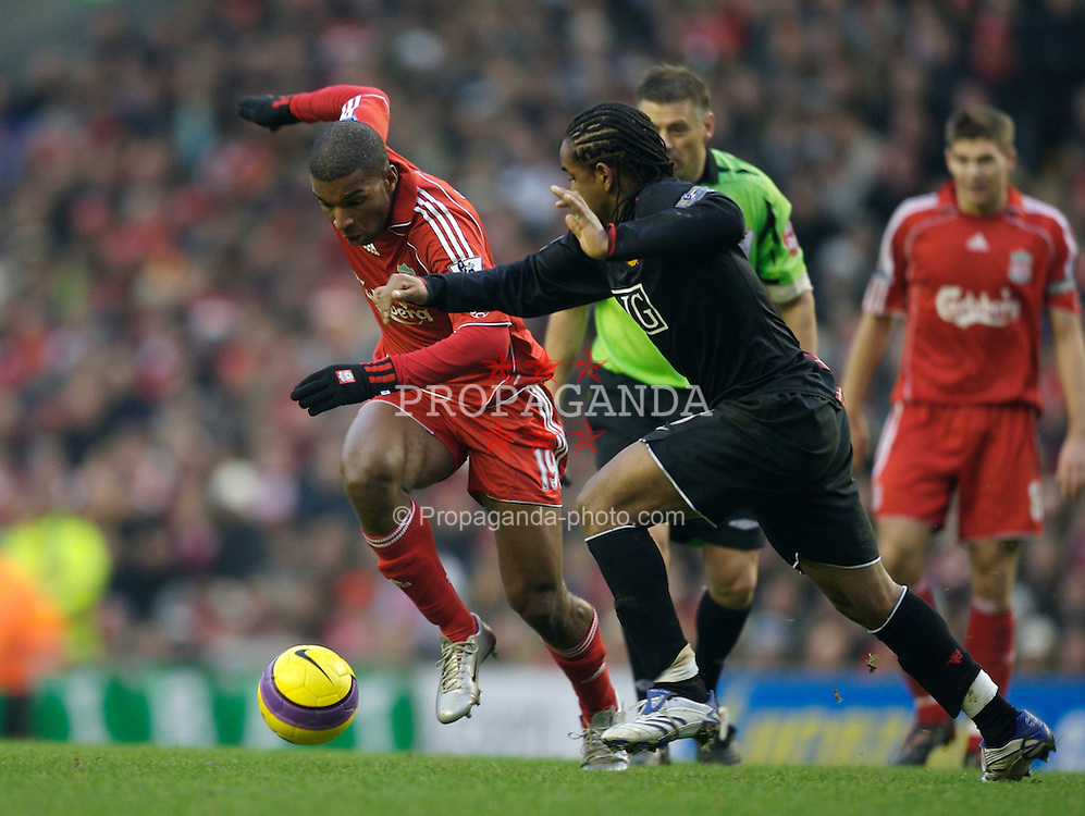 LIVERPOOL, ENGLAND - Sunday, December 16, 2007: Liverpool's Ryan Babel and Manchester United's Oliveira Anderson during the Premiership match at Anfield. (Photo by David Rawcliffe/Propaganda)