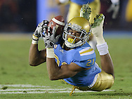 Redshirt sophomore cornerback Aaron Hester makes a diving interception of USC quarterback Matt Barkley during the UCLA Bruins' 28-14 loss to the USC Trojans at the Rose Bowl in Pasadena, Calif., on Saturday, Dec. 4, 2010.