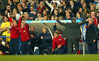Photo: Scott Heavey<br />Chelsea V Arsenal. FA Cup quarter final replay.<br />25/03/03.<br />TRhe Arsenal bench are jubilent as Claudio Ranieri turns away in digust during this London derby.