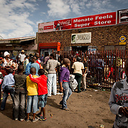 Children are watching as the community is looting a local supermarket during a violent protest in Soweto, South Africa. Some of them want to join and try to get into the store too, while others don't want to participate or become in trouble.  Januari 21st 2014<br /> <br /> Born Frees', as the South African people call the new generation of South Africa. It's the first generation born after the ending of the Apartheid in South Africa in 1994. These children didn't experience the oppression, segregation and the horrors of war, but are most vulnerable to the issues of a rapidly changing lifestyle. (De Beeldunie/ Frank Trimbos)