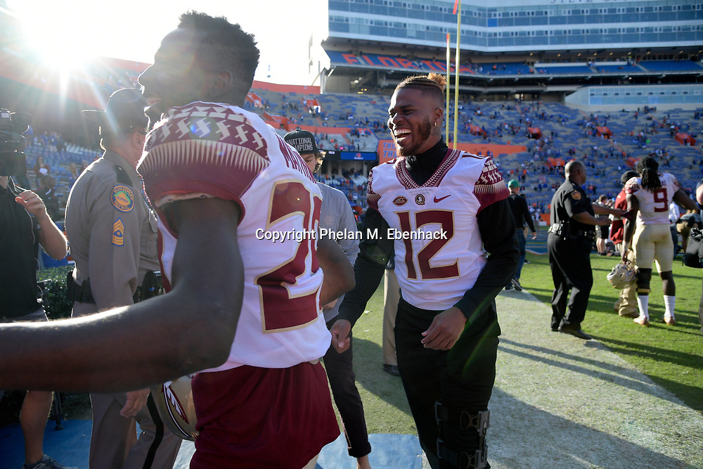 Florida State defensive back Nate Andrews (29) and quarterback Deondre Francois (12) leave the field after an NCAA college football game against Florida Saturday, Nov. 25, 2017, in Gainesville, Fla. FSU won 38-22. (Photo by Phelan M. Ebenhack)