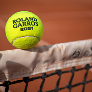 PARIS, FRANCE May 25. An official Roland Garros 2021 tournament tennis match ball at the 2021 French Open Tennis Tournament at Roland Garros on May 25th 2021 in Paris, France. (Photo by Tim Clayton/Corbis via Getty Images)