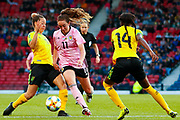 Lisa EVANS (Arsenal WFC (ENG)) of Scotland gets between the Jamaican pair of Chinyelu ASHER (Stabaek IF (NOR)) & Deniesha BLACKWOOD (Univ. West Florida (USA)) during the International Friendly match between Scotland Women and Jamaica Women at Hampden Park, Glasgow, United Kingdom on 28 May 2019.
