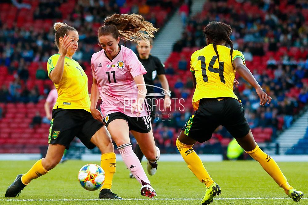 Lisa EVANS (Arsenal WFC (ENG)) of Scotland gets between the Jamaican pair of Chinyelu ASHER (Stabaek IF (NOR)) & Deniesha BLACKWOOD (Univ. West Florida (USA)) during the International Friendly match between Scotland Women and Jamaica Women at Hampden Park, Glasgow, United Kingdom on 28 May 2019.