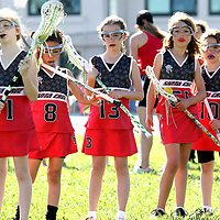The younger set lines up for drills during Santa Cruz Warriors girls' under-9 lacrosse practice at the field at the Branciforte Small Schools campus in Santa Cruz, California.<br /> Photo by Shmuel Thaler <br /> shmuel_thaler@yahoo.com www.shmuelthaler.com
