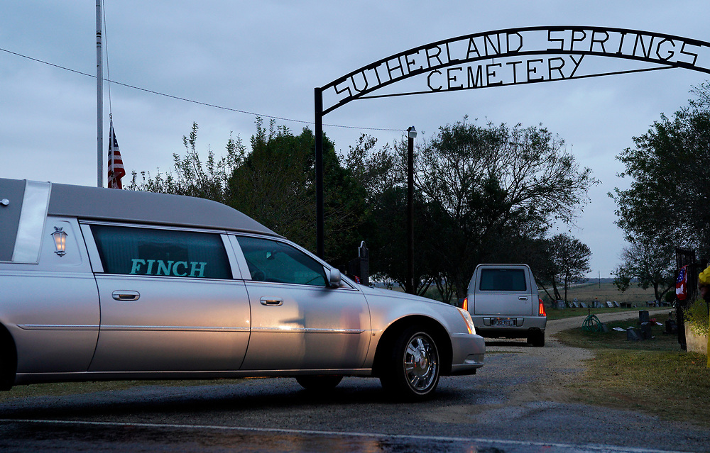 Two hearses arrive at the cemetery for the burial of Richard and Therese Rodriguez after the husband and wife were killed in the First Baptist Church of Sutherland Springs, Texas, U.S. November 11, 2017.  REUTERS/Rick Wilking