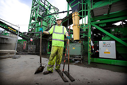 Olympic Park. Two large remediation plants have been created on the Olympic Park with soil washing machines installed to wash, sieve and shake out the contamination.<br />  <br /> Contamination of the area has built up through a century of neglect and heavy industrial use, making this one of the UK's most challenging land clean-up jobs. Picture shows Paul Grant, a labourer on the site. Picture taken on 03 Jun 09 by Dave Poultney. <br /> <br /> **model released**
