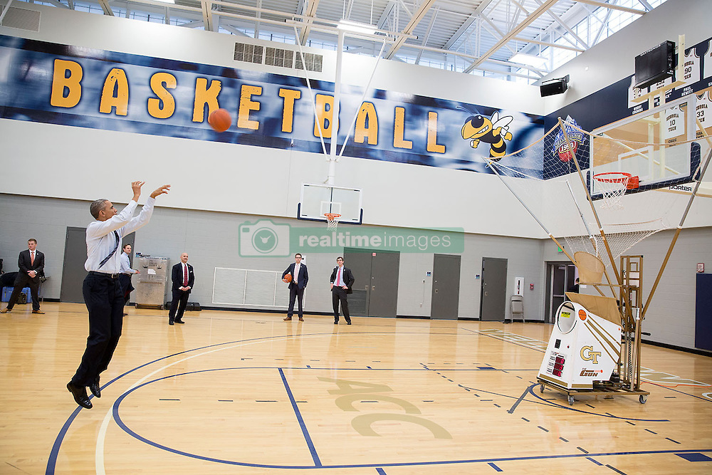 President Barack Obama takes a shot on the basketball court after he delivers remarks on education and college affordability at Georgia Tech in Atlanta, Ga., March 10, 2015. (Official White House Photo by Pete Souza)<br /> <br /> This official White House photograph is being made available only for publication by news organizations and/or for personal use printing by the subject(s) of the photograph. The photograph may not be manipulated in any way and may not be used in commercial or political materials, advertisements, emails, products, promotions that in any way suggests approval or endorsement of the President, the First Family, or the White House.