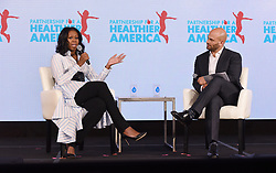 Former first lady Michelle Obama speaks as former White House chef Sam Kass looks on at the Healthier America's 2017 summit on May 12, 2017 at the Renaissance hotel in Washington, DC. Photo by Olivier Douliery/ Abaca