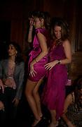 Camilla Al Fayad and Marietta Chandris dancing, Tatler magazine Little Black Book party, Tramp. Jermyn St. 10 November 2004. ONE TIME USE ONLY - DO NOT ARCHIVE  © Copyright Photograph by Dafydd Jones 66 Stockwell Park Rd. London SW9 0DA Tel 020 7733 0108 www.dafjones.com