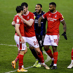 Yuri Ribeiro of Nottingham Forest tries to square up to Britt Assombalonga of Middlesbrough but is restrained by his teammates - Mandatory by-line: Robbie Stephenson/JMP - 20/01/2021 - FOOTBALL - City Ground - Nottingham, England - Nottingham Forest v Middlesbrough - Sky Bet Championship
