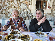 Cooking lunch at Popi and Costas's house. In and around Meronas village, Central Crete.