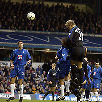 Copyright Sportsbeat. 0208 3926656<br />Picture: Henry Browne<br />Date: 8/02/2003<br />Birmingham v Chelsea FA Barclaycard Premiership<br />Eidur Gudjohnsen jumps above Kenny Cunningham to score Chelsea's second goal