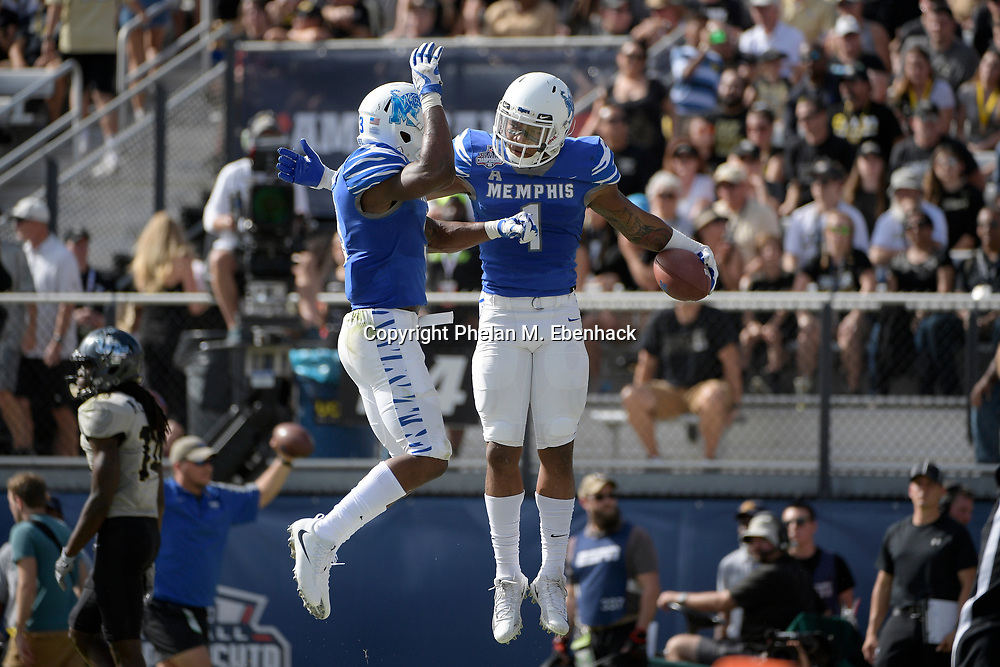 Memphis running back Tony Pollard (1) celebrates with wide receiver Anthony Miller (3) after catching a pass for a touchdown during the first half of the American Athletic Conference championship NCAA college football game against Central Florida Saturday, Dec. 2, 2017, in Orlando, Fla. (Photo by Phelan M. Ebenhack)