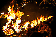 The Aarti of Goddess Ganga opens, the Pandits set fire to the oil lamps.