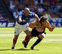 Copyright Sportsbeat Images. 01494 783165<br />Picture: Henry Browne<br />Date: 30/08/2003<br />Woverhampton Wanderers v Portsmouth FA Barclaycard Premiership<br />Steve Stone of Portsmouth hands off Lee Naylor of Wolves