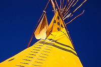 Yellow Tipi against dark blue sky