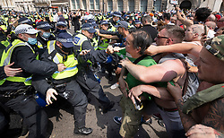 © Licensed to London News Pictures. 19/07/2021. London, UK. Police clash with protesters trying to reach Whitehall from Parliament Square in central London on Freedom Day. All covid regulations in England are being scrapped from today even though infections and hospitalisations are on the increase. Photo credit: Peter Macdiarmid/LNP
