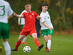 WREXHAM, WALES - Wednesday, October 30, 2019: Wales' Aaron Bennett (L) and Republic of Ireland's captain Darragh Reilly during the 2019 Victory Shield match between Wales and Republic of Ireland at Colliers Park. (Pic by David Rawcliffe/Propaganda)