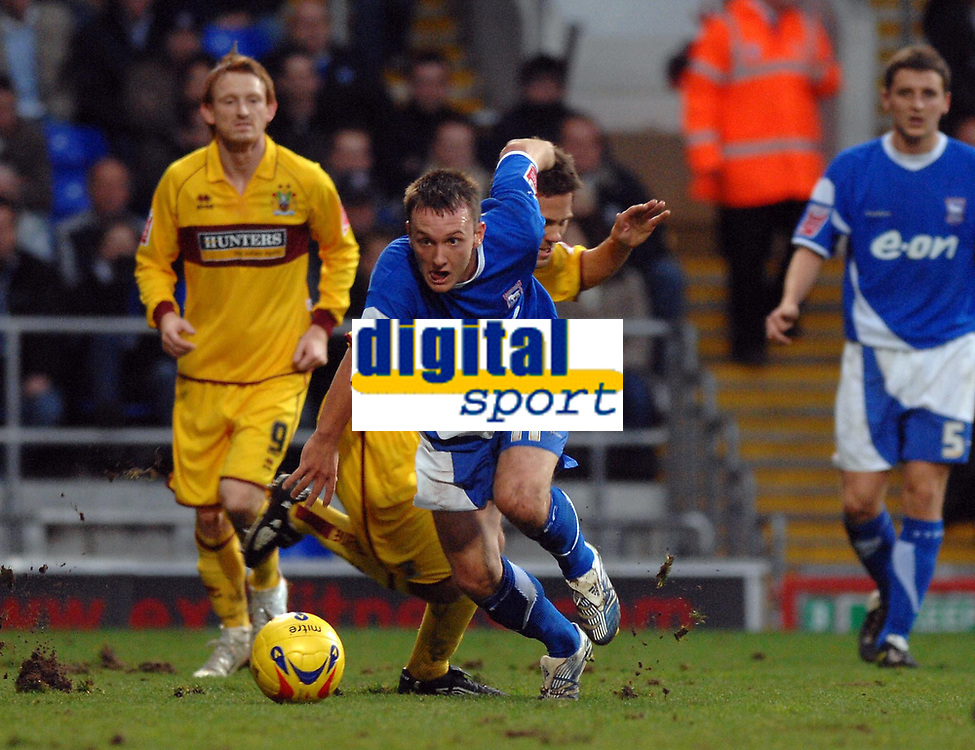 Photo: Ashley Pickering.<br />Ipswich Town v Burnley. Coca Cola Championship. 02/12/2006.<br />Ipswich's Gavin Williams (blue) gets away from his marker