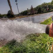 Fire hydrant releasing water because as a water main break was being repaired, NE 43rd & Antioch, Kansas City, Missouri.