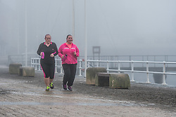 © London News Pictures. 21/02/2017. Aberystwyth, UK.<br /> Thick fog and mist engulfs walkers and joggers on Aberystwyth promenade in the early morning on damp and mild February day. Photo credit: Keith Morris/LNP