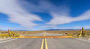 Metal cattle guard across a desolate highway in the Great Basin near Tonopah, Nevada