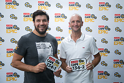Riaan Manser and new partner Denzyl O'Donoghoe receive their race numbers during the pre race events held at the V&A Waterfront in Cape Town prior to the start of the 2017 Absa Cape Epic Mountain Bike stage race held in the Western Cape, South Africa between the 19th March and the 26th March 2017<br /> <br /> Photo by Mark Sampson/Cape Epic/SPORTZPICS<br /> <br /> PLEASE ENSURE THE APPROPRIATE CREDIT IS GIVEN TO THE PHOTOGRAPHER AND SPORTZPICS ALONG WITH THE ABSA CAPE EPIC<br /> <br /> ace2016