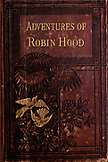 Book cover from The life and adventures of Robin Hood by Marsh, John B., Published by George Routledge and Sons, the Broadway, Ludgate in London ; New York in 1878. Robin Hood is a legendary heroic outlaw originally depicted in English folklore and subsequently featured in literature and film. According to legend, he was a highly skilled archer and swordsman. In some versions of the legend, he is depicted as being of noble birth, and in modern retellings he is sometimes depicted as having fought in the Crusades before returning to England to find his lands taken by the Sheriff. In the oldest known versions he is instead a member of the yeoman class. Traditionally depicted dressed in Lincoln green, he is said to have robbed from the rich and given to the poor.