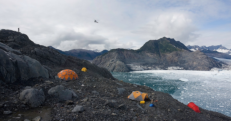 A helicopter flies into a remote research camp at the Columbia Glacier, near Valdez, Alaska, used by the Extreme Ice Survey and glaciologists from USGS and University of Colorado to monitor the glacier's rapid retreat.