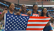 United States gold-medal winning 1,600-meter relay (from left): Sanya Richards, Jearl Miles-Clark, Demetria Washington and Me'Lisa Barber in the IAAF World Championships in Athletics at Stade de France on Sunday, Aug. 31, 2003.