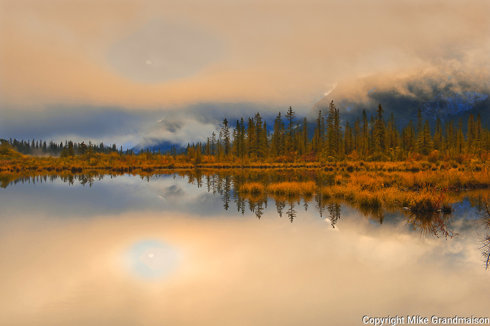 Vermillion Lakes shrouded in fog at sunrise<br />