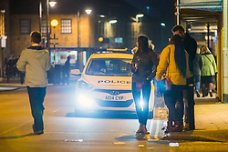 © Licensed to London News Pictures. 13/01/2018. Whittlesey UK. Picture shows police officers outside a kebab shop on Market street in Whittlesey where there has been an alleged stabbing at the The 39th Straw Bear Festival in Whittlesey, it is unclear where the incident happened but police activity is concentrated around a Kebab shop on Market street. The Straw Bear festival is taking place this weekend. In times past when starvation bit deep the ploughmen of the area where drawn to towns like Whittlesey, They knocked on doors begging for food & disguised their shame by blackening their faces with soot. In Whittlesey it was the custom on the Tuesday following Plough Monday to dress one of the confraternity of the plough in straw and call him a Straw Bear. The bear was then taken around town to entertain the folk who on the previous day had subscribed to the rustics, a spread of beer, tobacco & beef. The bear was made to dance in front of houses & gifts of money, beer & food was expected.Photo credit: Andrew McCaren/LNP